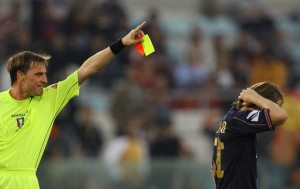Referee Girardi di San Dona di Piave gives a red card to Catania's midfielder David Baiocco, during their Italian serie A football match against Roma at Rome's Olympic stadium, 18 November 2006. Roma won 7-0.  AFP PHOTO / PATRICK HERTZOG  (Photo credit should read PATRICK HERTZOG/AFP/Getty Images)